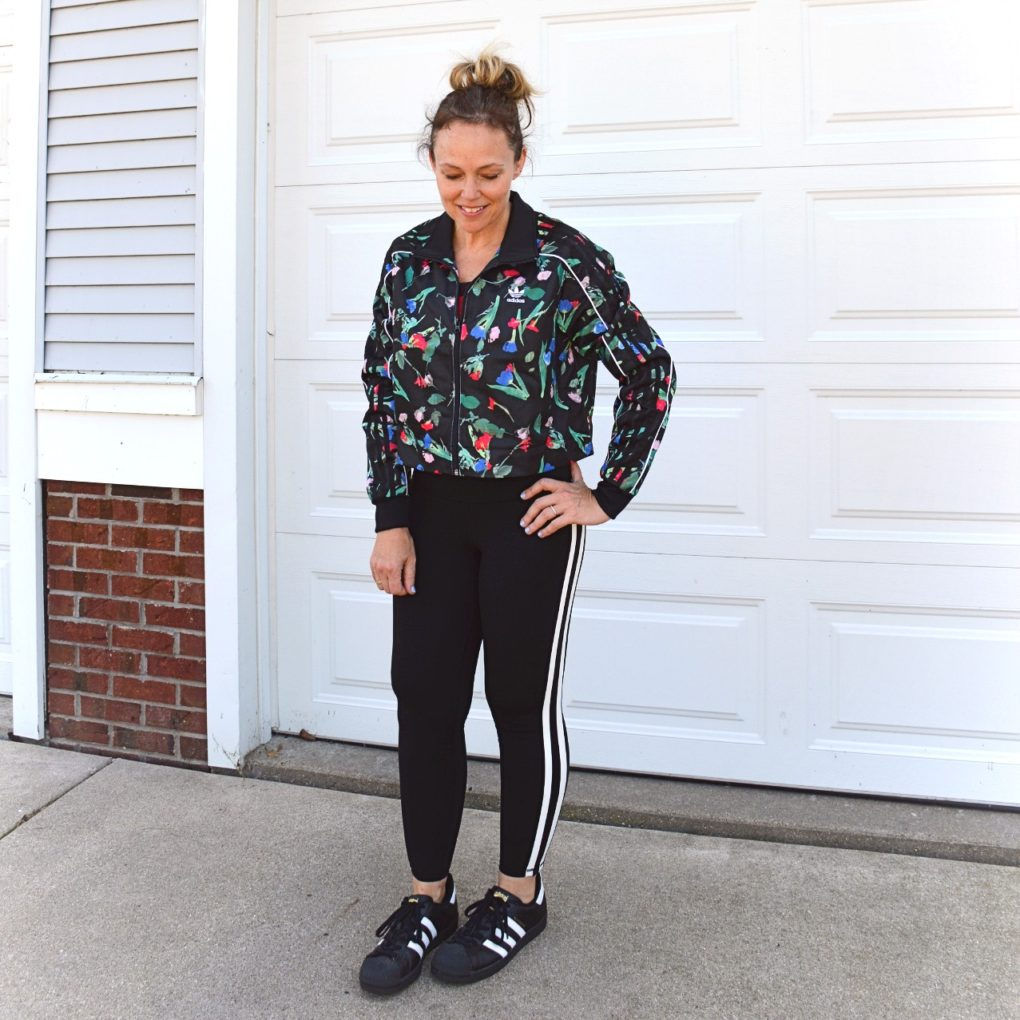 Adidas Bellista All Over Print Cropped Track Jacket, Old Navy striped leggings, and Superstars