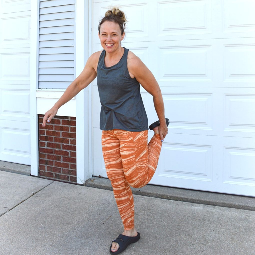 Adidas Wanderlust Believe This Tights in Glow Orange with Women's Response Tank in Charcoal Gray