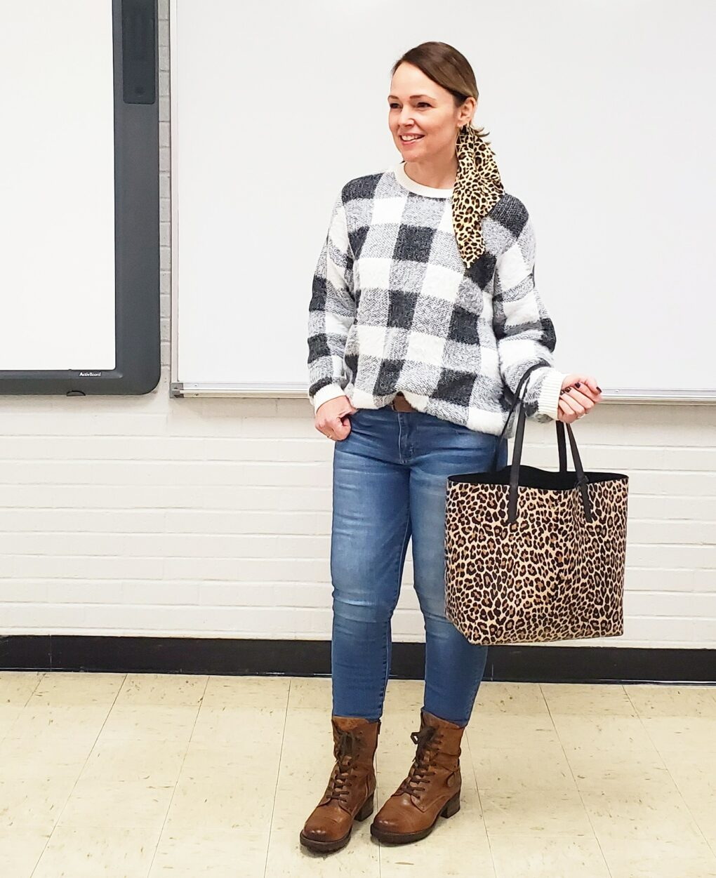Casual holiday outfit with soft buffalo plaid sweater and leopard print accessories