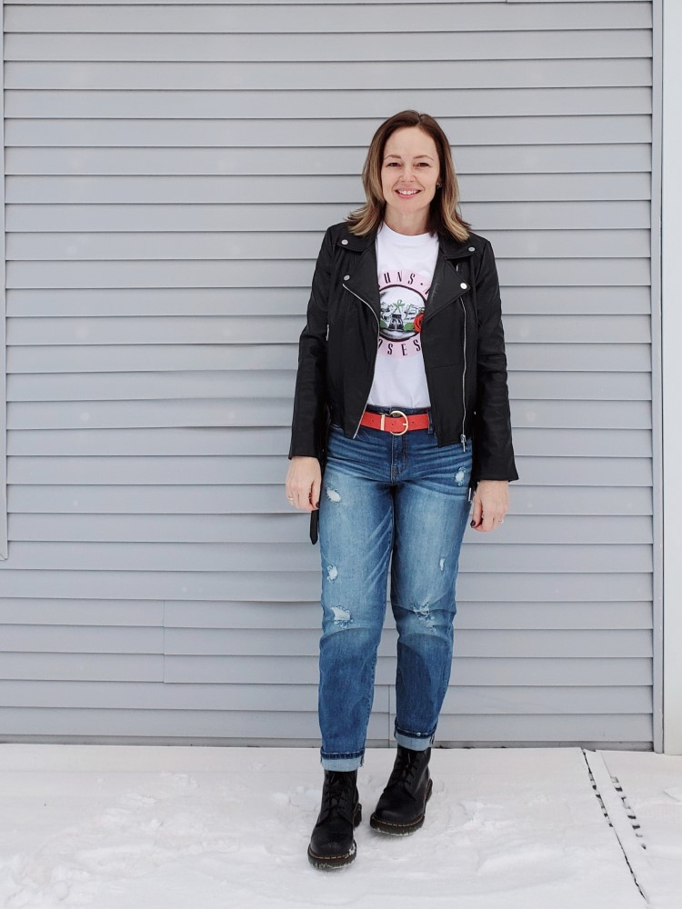 Casual everyday weekend look featuring a band tee, faux leather moto jacket, red belt, and Doc martens combat boots