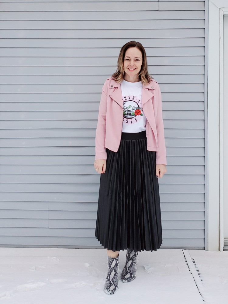 Casual outfit with pink moto jacket, Guns n Roses band tee, faux leather pleated skirt, and snakeskin boots