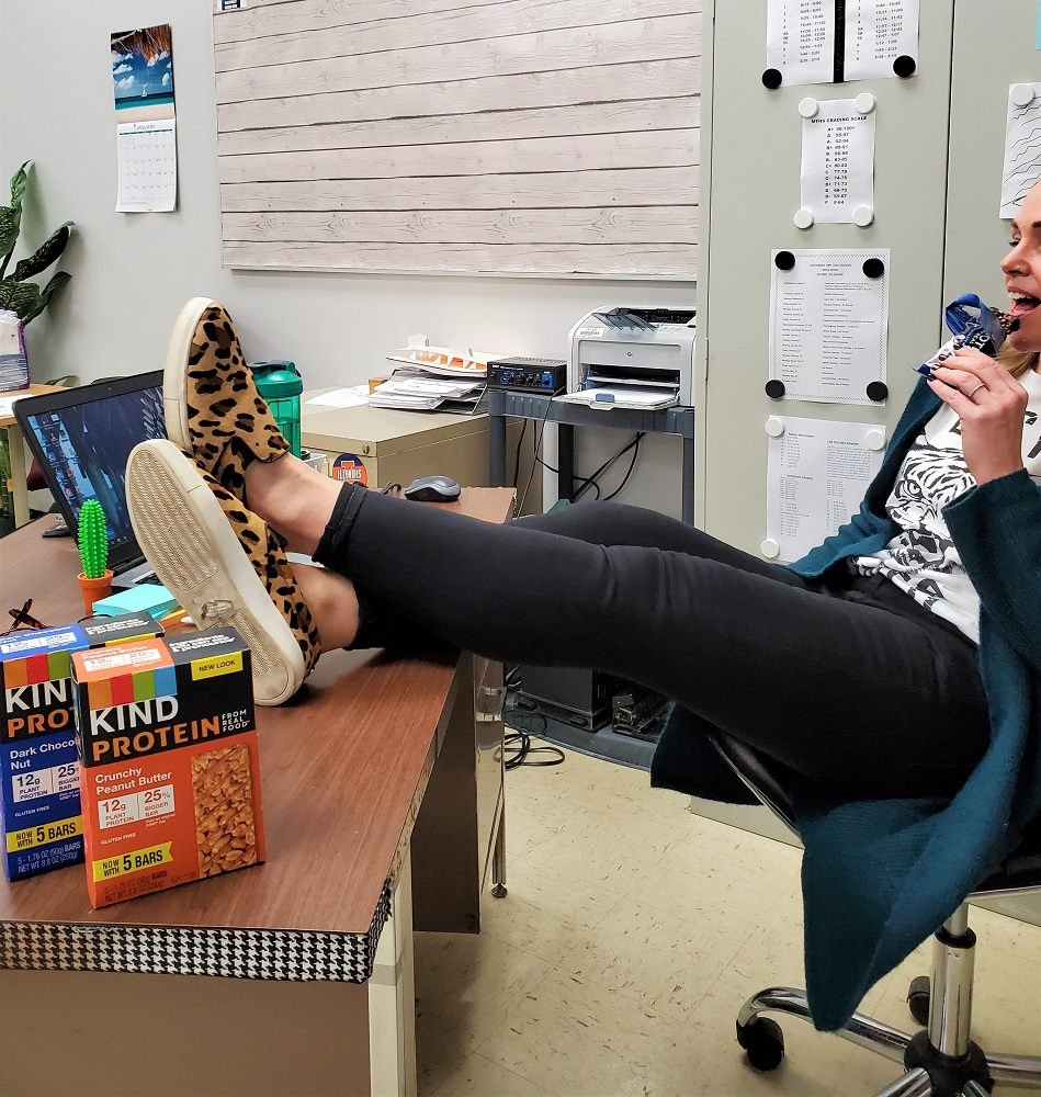 Everyday Teacher Style eating KIND protein bars for a snack while in the classroom