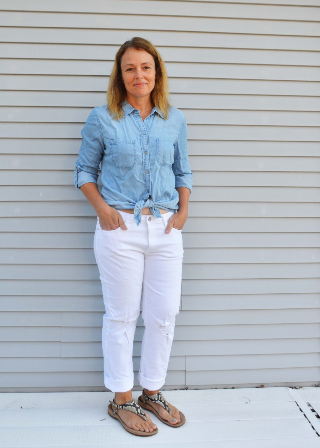 Chambray shirt knotted with white jeans and sandals