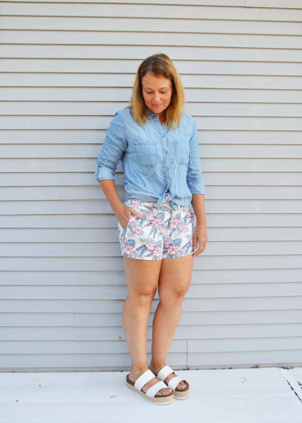 Chambray shirt knotted with floral print shorts