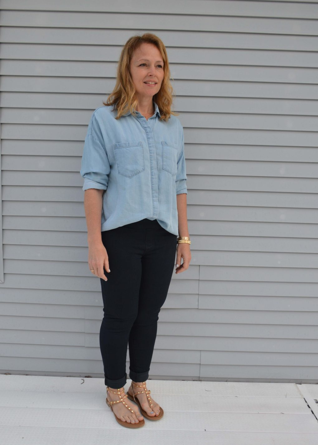 Lighter chambray with black jeans and studded sandals