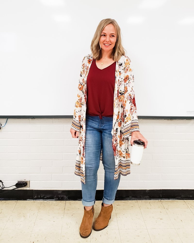 Teacher outfit featuring a fall floral kimono, jeans, and booties