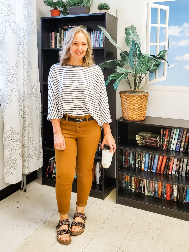 Fall teacher outfit featuring tan cognac pants, striped batwing top, and leopard sandals