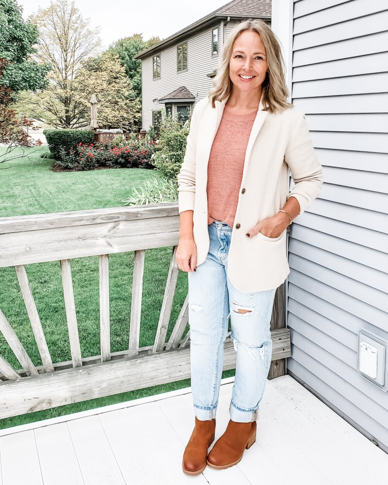 Fall teacher outfit featuring a white sweater knit blazer, rose sweater tank, distressed jeans, and Sorel boots