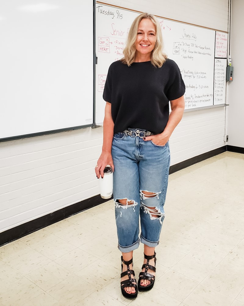 Teacher outfit with chunky batwing sweater with distressed jeans, gladiator sandals, and a snakeskin belt