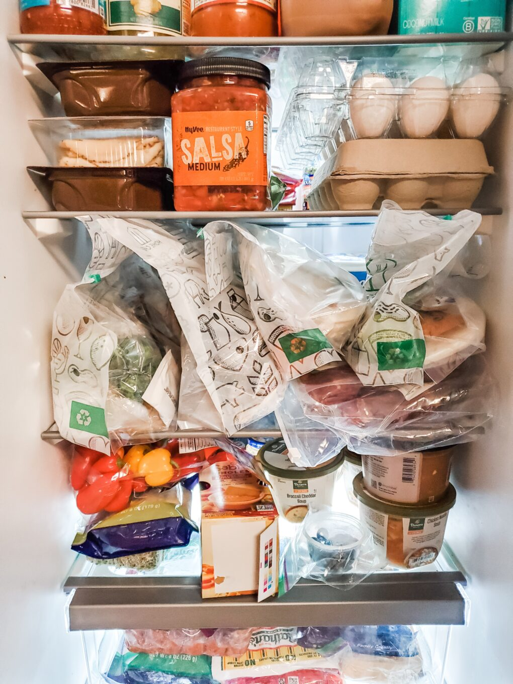 My refrigerator with Home Chef meal kits on the shelf