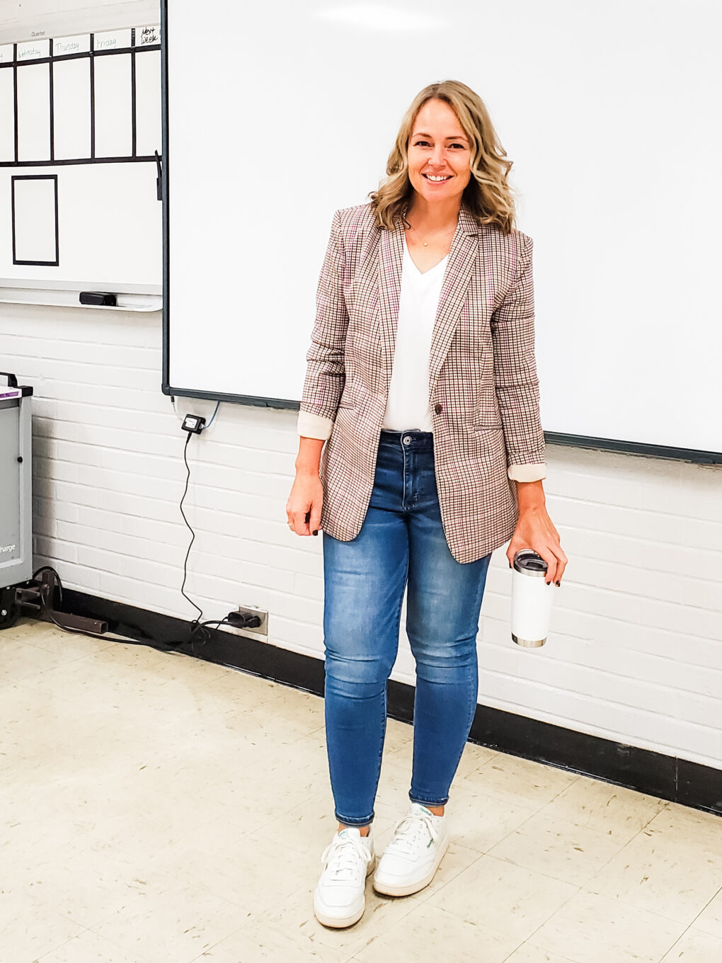 Teacher Outfit with plaid blazer, white tee, jeans, and white sneakers
