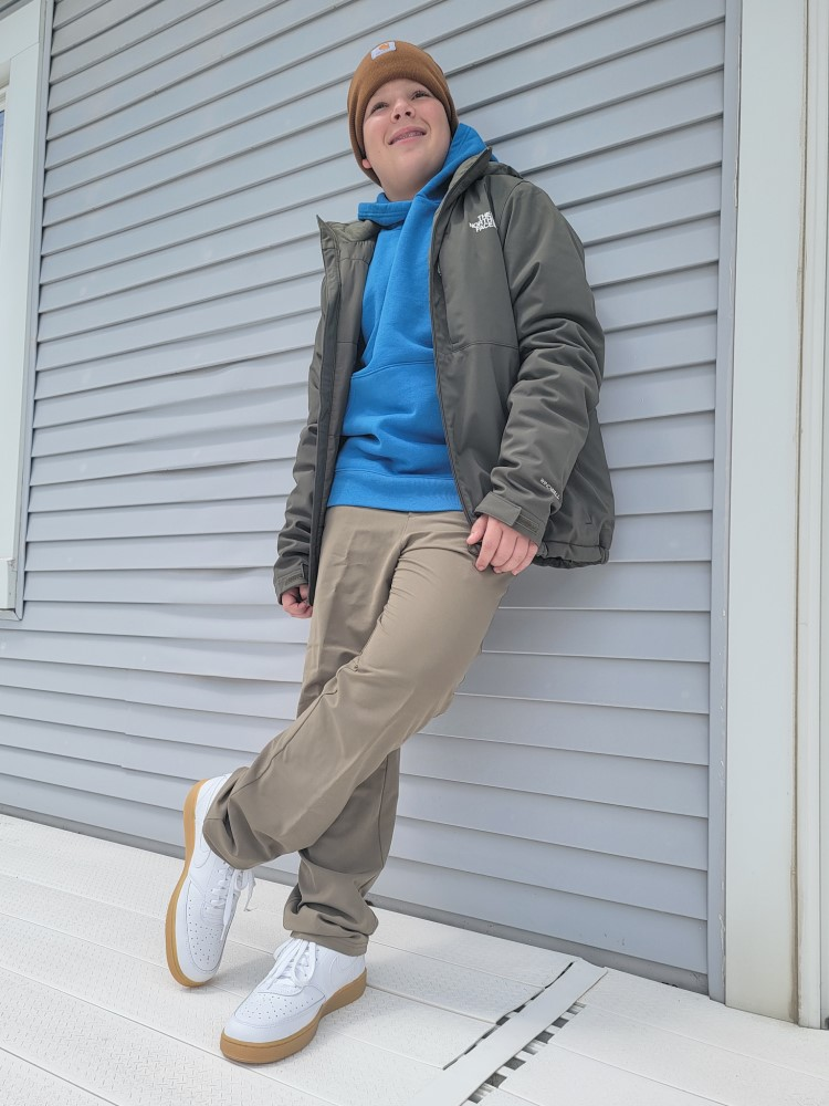 Jay in North Face Apex Elevation jacket, Carhartt Sweatshirt, and DSG Commuter Pant, and Nike Court Vision Shoes